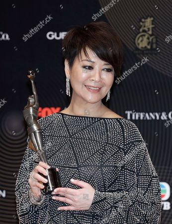 """Stock Photo of Taiwan actress Elaine Jin poses after winning the Best Supporting Actress award for his movie """"Mad World"""" during the Hong Kong Film Awards in Hong Kong"""