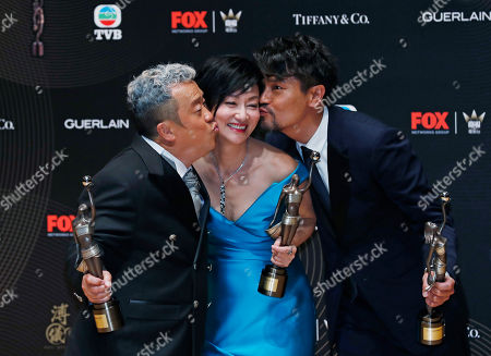 Kara Wai, Gordon Lam, Eric Tsang From right, Hong Kong actor Gordon Lam, actress Kara Wai and Eric Tsang pose after winning the Best Actress, Best Supporting Actor and Best Actor awards during the Hong Kong Film Awards in Hong Kong