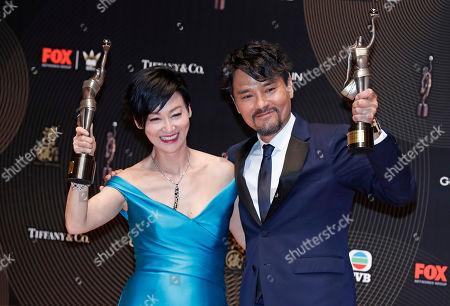 Stock Picture of Kara Wai, Gordon Lam Hong Kong actress Kara Wai, left and actor Gordon Lam pose after winning the Best Actress and Best Actor awards during the Hong Kong Film Awards in Hong Kong