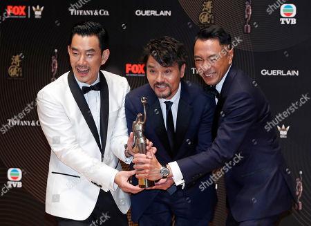Gordon Lam, Philip Keung, Richie Ren Hong Kong actor Gordon Lam, center, poses with his colleagues actors Philip Keung, right, and Richie Ren after winning the Best Actor award during the Hong Kong Film Awards in Hong Kong