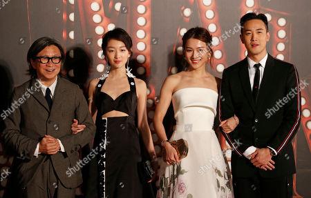 Derek Tsang, Venus Wong, Zhou Dongyu, Peter Chan From right, Hong Kong director Derek Tsang, his girlfriend Venus Wong, Chinese actress Zhou Dongyu and Hong Kong director Peter Chan pose on the red carpet of the Hong Kong Film Awards in Hong Kong