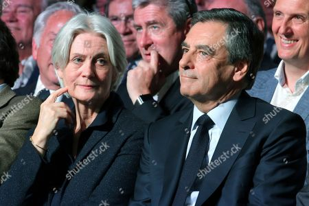 Conservative French presidential candidate Francois Fillon, right, and his wife Penelope attend a campaign meeting in Paris, France, . The two-round presidential election is set for April 23 and May 7