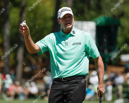 Stock Image of Steven Stricker reacts after his eagle on the second hole during the final round of the Masters golf tournament, in Augusta, Ga