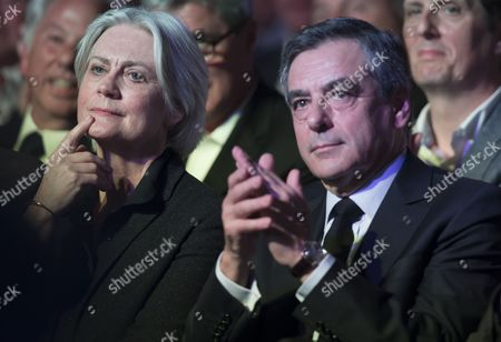 Stock Image of French presidential election candidate for the right-wing party, Les Republicains (LR) Francois Fillon (R) sits beside his wife Penelope (L) as they attend a campaign rally at the Porte de Versailles in Paris, France, 09 April 2017. The French presidential election is scheduled for 23 April and 07 May 2017.