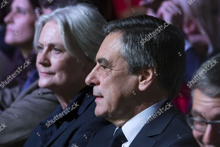 Stock Picture of French presidential election candidate for the right-wing party, Les Republicains (LR) Francois Fillon (R) sits beside his wife Penelope (L) as they attend a campaign rally at the Porte de Versailles in Paris, France, 09 April 2017. The French presidential election is scheduled for 23 April and 07 May 2017.