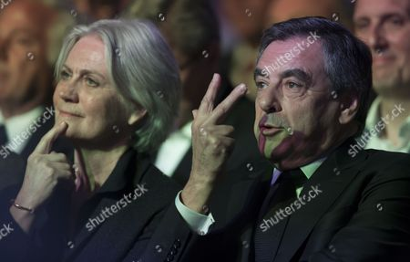 French presidential election candidate for the right-wing party, Les Republicains (LR) Francois Fillon (R) sits beside his wife Penelope (L) as they attend a campaign rally at the Porte de Versailles in Paris, France, 09 April 2017. The French presidential election is scheduled for 23 April and 07 May 2017.