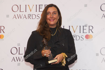 Stock Picture of Katrina Lindsay accepts the award for Best Costume Design for Harry Potter And The Cursed Child at Palace Theatre