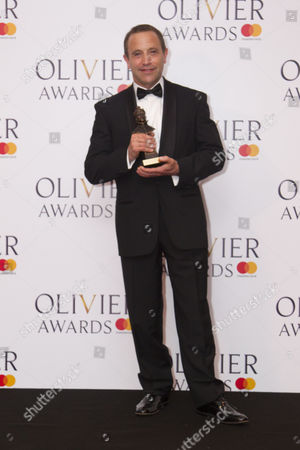 Mark Wigglesworth accepts the award for Outstanding Achievement in Opera for Don Giovanni and Lulu at London Coliseum