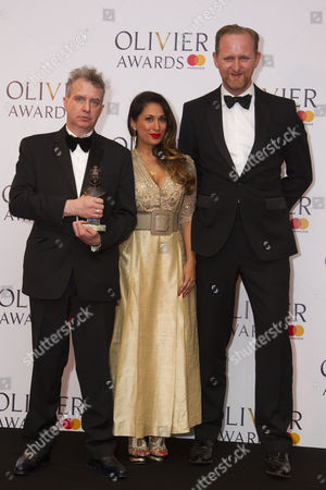 Bob Holland and Phelim McDermott accept the award for Best New Opera Production Akhnaten at London Coliseum, presented by Preeya Kalidas