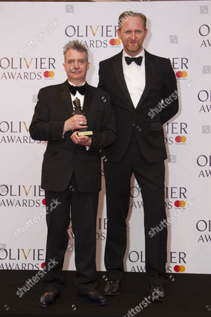 Stock Picture of Bob Holland and Phelim McDermott accept the award for Best New Opera Production Akhnaten at London Coliseum