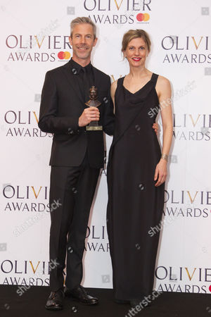 Stock Picture of Crystal Pite and Jonathon Young accept the award for Best New Dance Production for Betroffenheit at Sadler's Wells