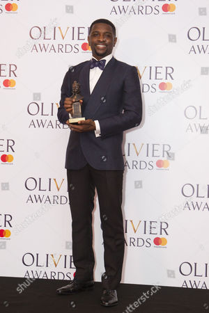 Adam J Bernard accepts the award for Best Actor in a Supporting Role in a Musical for Dreamgirls at Savoy Theatre
