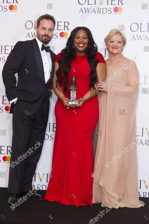 Amber Riley accepts the award for Best Actress in a Musical for Dreamgirls at Savoy Theatre, presented by Alfie Boe and Maria Friedman