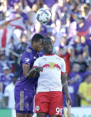 Orlando City's Jonathan Spector, left, and New York Red Bulls's Bradley Wright-Phillips (99) go after a ball during the second half of an MLS soccer game, in Orlando, Fla. Orlando won 1-0