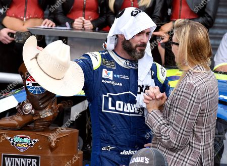 Jimmie Johnson, Chandra Johnson Jimmie Johnson wears a towel over his head as he cools off while talking with his wife Chandra in victory lane after winning the NASCAR Cup Series auto race at Texas Motor Speedway in Fort Worth, Texas