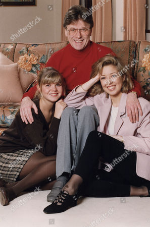 Stock Photo of Mike Yarwood, (L) Charlotte Yarwood, (R) Clare Yarwood Comedian and his two daughters at his Surrey home.....