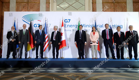 From left, European Commissioner for Cimate, Miguel Arias Canete, Energy ministers, Germany's Rainer Baake, United States' Rick Perry, Canada's James Gordon Carr, Italy's Carlo Calenda, France's Segolene Royal, Britain's Nick Hurd, Japan's Yosuke Takagi and International Energy Agency Executive Director Faith Birol pose for a family photo during a G7 Energy meeting, in Rome