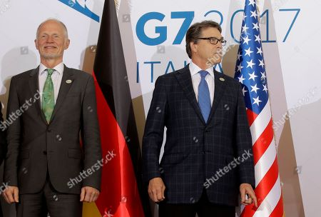 Stock Image of Energy ministers Rainer Baake of Germany, left, and Rick Perry, of the United States pose for a photo during a G7 Energy meeting, in Rome., Monday, April 10, 2017