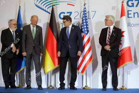 From left, European Commissioner for Cimate, Miguel Arias Canete, Energy ministers Germany's Rainer Baake, United States' Rick Perry, and Canada's James Gordon Carr pose for a photo during a G7 Energy meeting, in Rome