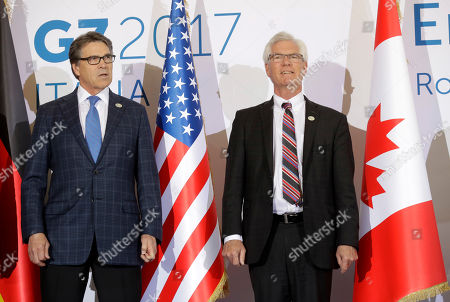 Energy ministers, United State's Rick Perry, left, and Canada's James Gordon Carr, pose for a photo during a G7 Energy meeting, in Rome