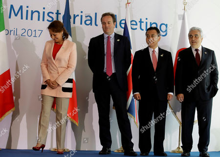 Stock Image of From left, Energy ministers, France's Segolene Royal, Britain's Nick Hurd, Japan's Yosuke Takagi of Japan and International Energy Agency Executive Director Faith Birol pose for a photo during a G7 Energy meeting, in Rome