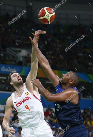 Pau Gasol (l) of Spain and Boris Diaw of France in Action During the Men's Basketball Quarter Final Match Between Spain and France of the Rio 2016 Olympic Games at the Carioca Arena 1 in the Olympic Park in Rio De Janeiro Brazil 17 August 2016 Brazil Rio De Janeiro
