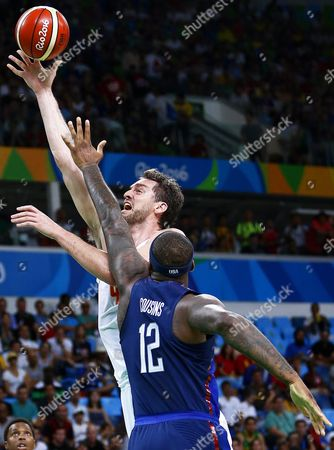 Pau Gasol (l) of Spain in Action Against Demarcus Cousins (r) of the Usa During the Men's Basketball Semi Final Game Between Spain and the Usa at the Rio 2016 Olympic Games at the Carioca Arena 1 in the Olympic Park in Rio De Janeiro Brazil 19 August 2016 Brazil Rio De Janeiro