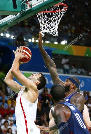 Felipe Reyes (l) of Spain in Action Against Demarcus Cousins (r) of the Usa During the Men's Basketball Semi Final Game Between Spain and the Usa at the Rio 2016 Olympic Games at the Carioca Arena 1 in the Olympic Park in Rio De Janeiro Brazil 19 August 2016 Brazil Rio De Janeiro