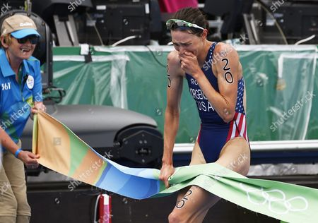 Gwen Jorgensen (r) of the Usa Reacts While Crossing the Finish Line to Win the Gold Medal in the Women's Triathlon Race of the Rio 2016 Olympic Games at Fort Copacabana in Rio De Janeiro Brazil 20 August 2016 Brazil Rio De Janeiro