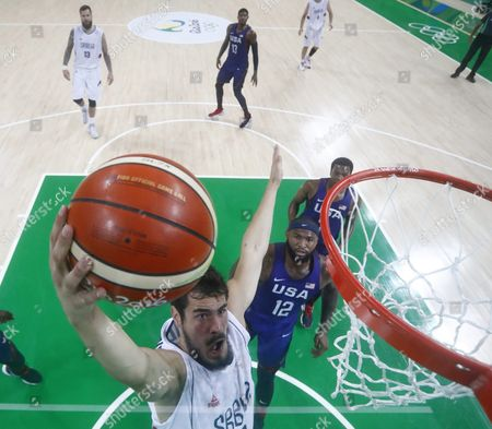 Nikola Kalinic of Serbia (l) Goes to the Basket As Demarcus Cousins (r) Looks on During the Men's Gold Medal Basketball Game of the Rio 2016 Olympic Games at the Carioca Arena 1 in the Olympic Park in Rio De Janeiro Brazil 21 August 2016 Brazil Rio De Janeiro