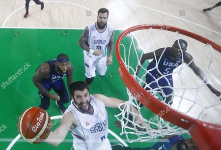 Stock Picture of Stefan Markovic of Serbia (c) Goes to the Basket As Demarcus Cousins of Usa (l) and Kevin Durant of Usa (r) Looks on During the Men's Gold Medal Basketball Game of the Rio 2016 Olympic Games at the Carioca Arena 1 in the Olympic Park in Rio De Janeiro Brazil 26 August 2016 Brazil Rio De Janeiro