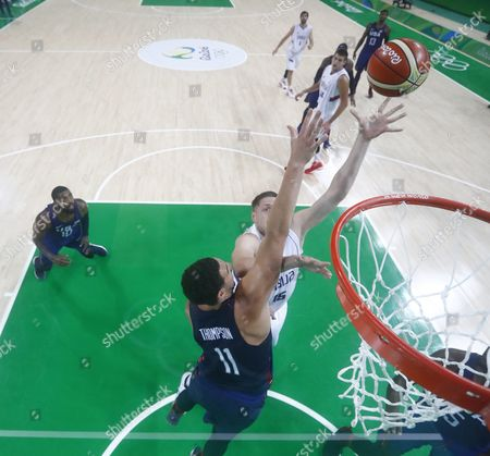 Vladimir Stimac of Serbia (r) Shoots As Klay Thompson of the Usa (l) Defends During the Men's Gold Medal Basketball Game of the Rio 2016 Olympic Games at the Carioca Arena 1 in the Olympic Park in Rio De Janeiro Brazil 21 August 2016 Brazil Rio De Janeiro