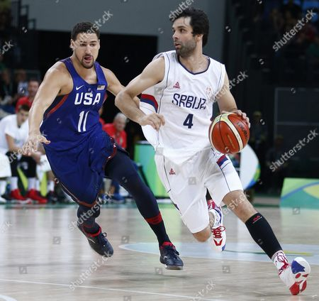 Milos Teodosic of Serbia (r) in Action Against Klay Thompson of the Usa (r) During the Men's Basketball Gold Medal Game of the Rio 2016 Olympic Games at the Carioca Arena 1 in the Olympic Park in Rio De Janeiro Brazil 21 August 2016 Brazil Rio De Janeiro
