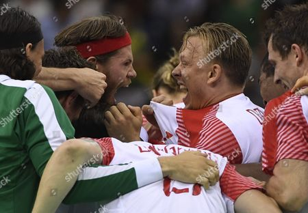 Mikkel Hansen (c-l) and Morten Olsen (c-r) of Denmark Celebrate After Defeating Poland in Men's Semifinal Handball Game of the Rio 2016 Olympic Games at the Future Arena in the Olympic Park in Rio De Janeiro Brazil 19 August 2016 Brazil Rio De Janeiro