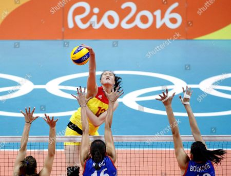 Ruoqi Hui (facing) of China Spikes the Ball During the Women's Volleyball Gold Medal Match Between China and Serbia of the Rio 2016 Olympic Games at Maracanazinho Indoor Arena in Rio De Janeiro Brazil 20 August 2016 Brazil Rio De Janeiro