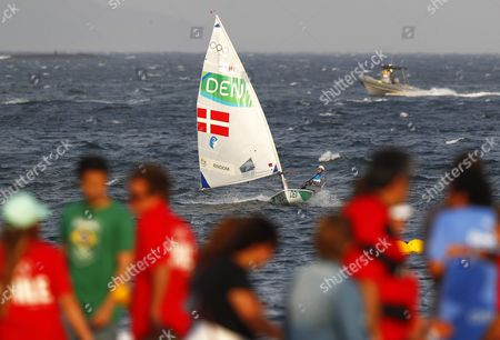 Spectators Watch Anne-marie Rindom of Denmark Saling Ahead of the Postponed Women's Laser Radial Medal Race of the Rio 2016 Olympic Games Sailing Events in Rio De Janeiro Brazil 15 August 2016 After a Windless Morning Strong Breeze in the Afternoon Forced the Cancellation of All Races Brazil Rio De Janeiro