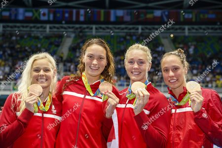 Bronze Medalists Pernille Blume (l-r) Mie Nielsen Jeanette Ottensen and Rikke Moller Pedersen of Denmark Pose For the Media During the Lap of Honour After the Medal Ceremony For the Women's 4x100m Medley Relay Final Race of the Rio 2016 Olympic Games Swimming Events at Olympic Aquatics Stadium at the Olympic Park in Rio De Janeiro Brazil 13 August 2016 Brazil Rio De Janeiro