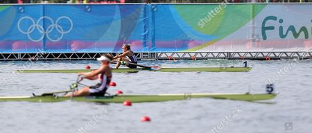 Genevra Stone of the Us (b) and Fie Udby Erichsen of Denmark (f) in Action During the Women's Single Sculls Heats of the Rio 2016 Olympic Games Rowing Events at the Lagoa Rodrigo De Freitas in Rio De Janeiro Brazil 06 August 2016 Brazil Rio De Janeiro