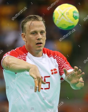 Morten Olsen of Denmark Passes the Ball During the Men's Handball Gold Medal Match of the Rio 2016 Olympic Games Between Denmark and France at the Future Arena in the Olympic Park in Rio De Janeiro Brazil 21 August 2016 Brazil Rio De Janeiro