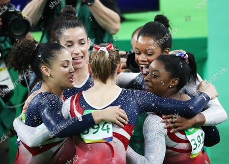 (from Left Clockwise) Lauren Hernandez Alexandra Raisman Gabrielle Douglas Simone Biles and Madison Kocian of the Usa Celebrate After Winning the Women's Team Final of the Rio 2016 Olympic Games Artistic Gymnastics Events at the Rio Olympic Arena in Barra Da Tijuca Rio De Janeiro Brazil 09 August 2016 Brazil Rio De Janeiro
