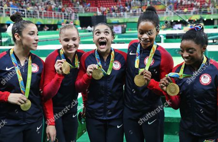 (from Left) Alexandra Raisman Madison Kocian Lauren Hernandez Gabrielle Douglas and Simone Biles of the Usa Pose with Their Gold Medals After Winning the Women's Team Final of the Rio 2016 Olympic Games Artistic Gymnastics Events at the Rio Olympic Arena in Barra Da Tijuca Rio De Janeiro Brazil 09 August 2016 Brazil Rio De Janeiro