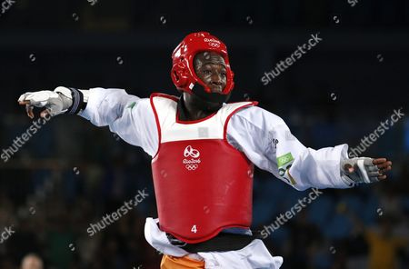 Cheick Sallah Junior Cisse of Cote D'ivoire Celebrates After Defeating Lutalo Muhammad of Great Britain During the Men's -80kg Gold Medal Bout of the Rio 2016 Olympic Games Taekwondo Events at the Carioca Arena 3 in the Olympic Park in Rio De Janeiro Brazil 19 August 2016 Brazil Rio De Janeiro