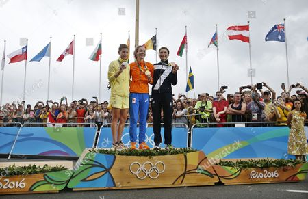 Winner Anna Van Der Breggen of the Netherlands is Flanked by Silver Medalist Emma Johansson (l) of Sweden and Bronze Medal Winner Elisa Longo Borghini (r) During the Medal Ceremony For the Women's Road Cycling Race of the Rio 2016 Olympic Games at Fort Copacabana in Rio De Janeiro Brazil 07 August 2016 Brazil Rio De Janeiro