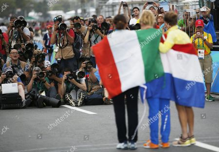 Winner Anna Van Der Breggen of the Netherlands is Flanked by Silver Medalist Emma Johansson (r) of Sweden and Bronze Medal Winner Elisa Longo Borghini (l) During the Medal Ceremony For the Women's Road Cycling Race of the Rio 2016 Olympic Games at Fort Copacabana in Rio De Janeiro Brazil 07 August 2016 Brazil Rio De Janeiro