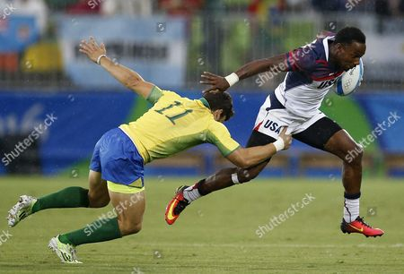 Carlin Isles of Usa (r) Escapes Gustavo Albuquerque of Brazil (l) During the Men's Rugby Sevens Placing Match Between Usa and Brazil of the Rio 2016 Olympic Games at the Deodoro Stadium in Rio De Janeiro Brazil 10 August 2016 Brazil Rio De Janeiro