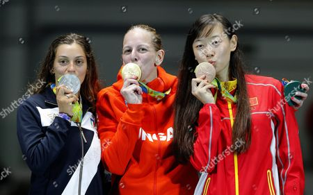 Emese Szasz (c) of Hungary Poses with Her Gold Medal on the Podium After Winning the Women's Epee Individual of the Rio 2016 Olympic Games Fencing Events at the Carioca Arena 3 in the Olympic Park in Rio De Janeiro Brazil 06 August 2016 Szasz Won Ahead of Second Placed Rossella Fiamingo (l) of Italy and Third Placed Sun Yiwen (r) of China Brazil Rio De Janeiro