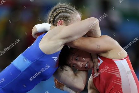Eri Tosaka (red) of Japan in Action Against Mariya Stadnik of Azerbaijan During the Women's Freestyle 48kg Gold Medal Game of the Rio 2016 Olympic Games Wrestling Events at the Carioca Arena 2 in the Olympic Park in Rio De Janeiro Brazil 17 August 2016 Brazil Rio De Janeiro