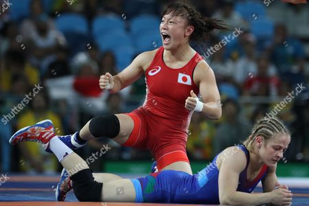Eri Tosaka (red) of Japan Celebrates After Winning the Wrestle Against Mariya Stadnik of Azerbaijan During the Women's Freestyle 48kg Gold Medal Game of the Rio 2016 Olympic Games Wrestling Events at the Carioca Arena 2 in the Olympic Park in Rio De Janeiro Brazil 17 August 2016 Brazil Rio De Janeiro