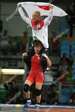 Eri Tosaka (down) of Japan Celebrates with Her Coach Kazuhito Sakae on Her Shoulders After Winning the Wrestle Against Mariya Stadnik of Azerbaijan During the Women's Freestyle 48kg Gold Medal Game of the Rio 2016 Olympic Games Wrestling Events at the Carioca Arena 2 in the Olympic Park in Rio De Janeiro Brazil 17 August 2016 Brazil Rio De Janeiro