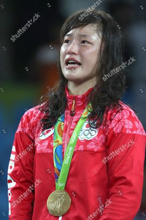Stock Image of Gold Medal Winner Eri Tosaka of Japan Listens to the National Anthem During the Awarding Ceremony of the Women's Freestyle 48kg Game of the Rio 2016 Olympic Games Wrestling Events at the Carioca Arena 2 in the Olympic Park in Rio De Janeiro Brazil 17 August 2016 Brazil Rio De Janeiro